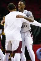 TSU's Jalan McCloud, right, who had 17 points, celebrates the win.