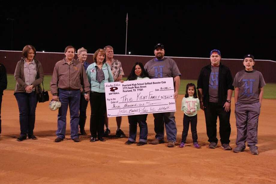 The Kent family was this year's honoree in the ninth annual Haynie Spirit Strike Out Cancer softball tournament hosted by Pearland and Dawson High Schools. The Kents received a $3,000 check from funds and donations raised throughout the tournament to help fight the battle against cancer. Photo: Submitted Photo