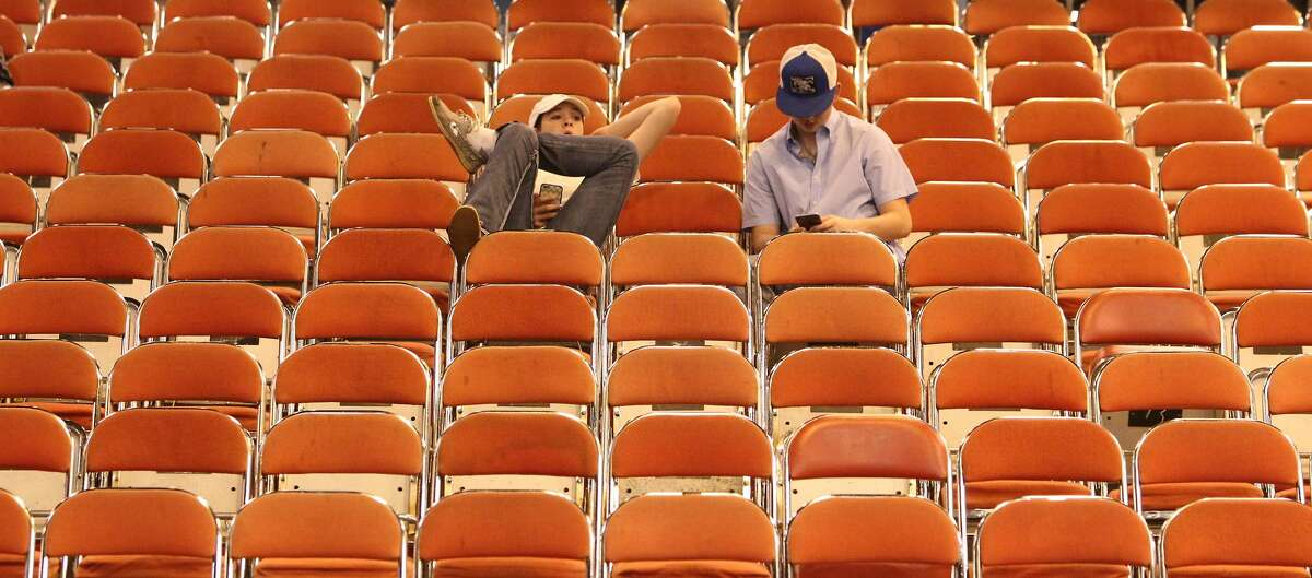 Carleigh Judd (left) and her brother Cade Judd relax in NRG Main Arena between shows at 2017 Houston Livestock and Rodeo Saturday, March 11, 2017, in Houston. ( Steve Gonzales / Houston Chronicle )