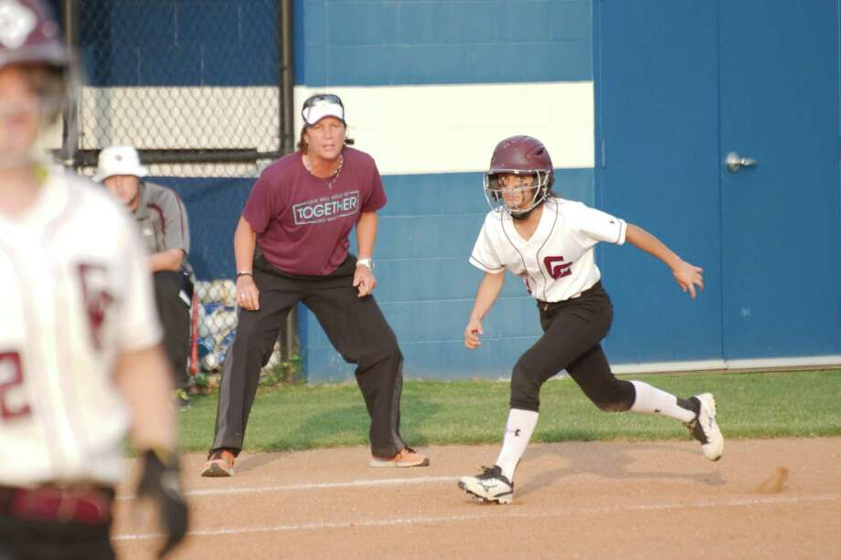 Clear Creek softball coach Andrea Cash, encouraging runner Carah Delao, has a strong team which can compete for the District 24-6A title this spring. Photo: Kirk Sides / © 2015 Kirk Sides / Houston Community Newspapers
