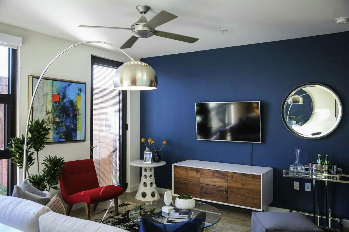 The living room in a model one-bedroom at the One Henry Adams apartment complex in San Francisco's Design District, which is gradually attracting residents.