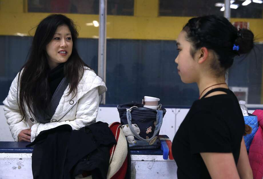 Olympic gold medalist Kristi Yamaguchi meets with current United States figure skating champion Karen Chen during a training session at the Sharks Ice skating rink in Fremont, Calif. on Saturday, March 11, 2017. Yamaguchi has been mentoring the 17-year-old Chen, who will be competing in the world championship in Finland beginning March 29. Photo: Paul Chinn, The Chronicle