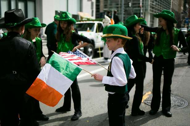 Alan McLaughlin, 8, of Murphy Irish Dancers stands with the Irish and American flag before the start of the 166th Annual San Francisco St. Patrick�s Day Parade in San Francisco, Calif. Saturday, March 11, 2017.