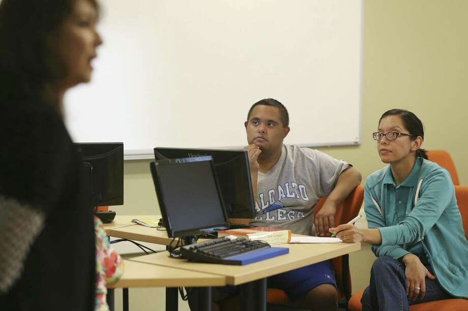 Steven Lopez, 24, listens as business instructor Sylvia de Hoyos, left, goes over material during a final exam review for the Project Access course at Palo Alto College, Thursday, March 9, 2017. The pilot program is currently preparing seven students with intellectual disabilities to earn an administrative assistant certification. Sitting with Lopez is work study student, Nicole Ramiez. Photo: JERRY LARA, Staff / San Antonio Express-News / © 2017 San Antonio Express-News