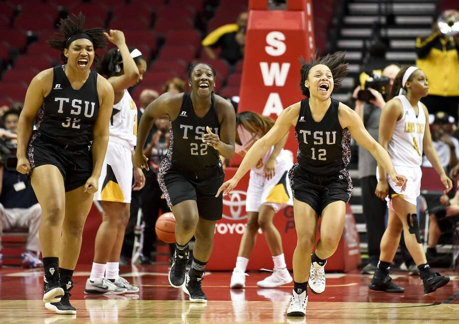 Texas Southern's Chynna Ewing (12), Breasia McElrath (22), and Nycolle Smith celebrate their 70-66 victory over Grambling as Grambling's Monisha Neal, right, walks off the court in an NCAA college basketball game in the championship of the Southwestern Athletic Conference, Saturday,  March 11, 2017, in Houston. (AP Photo/Eric Christian Smith) Photo: Eric Christian Smith/Associated Press