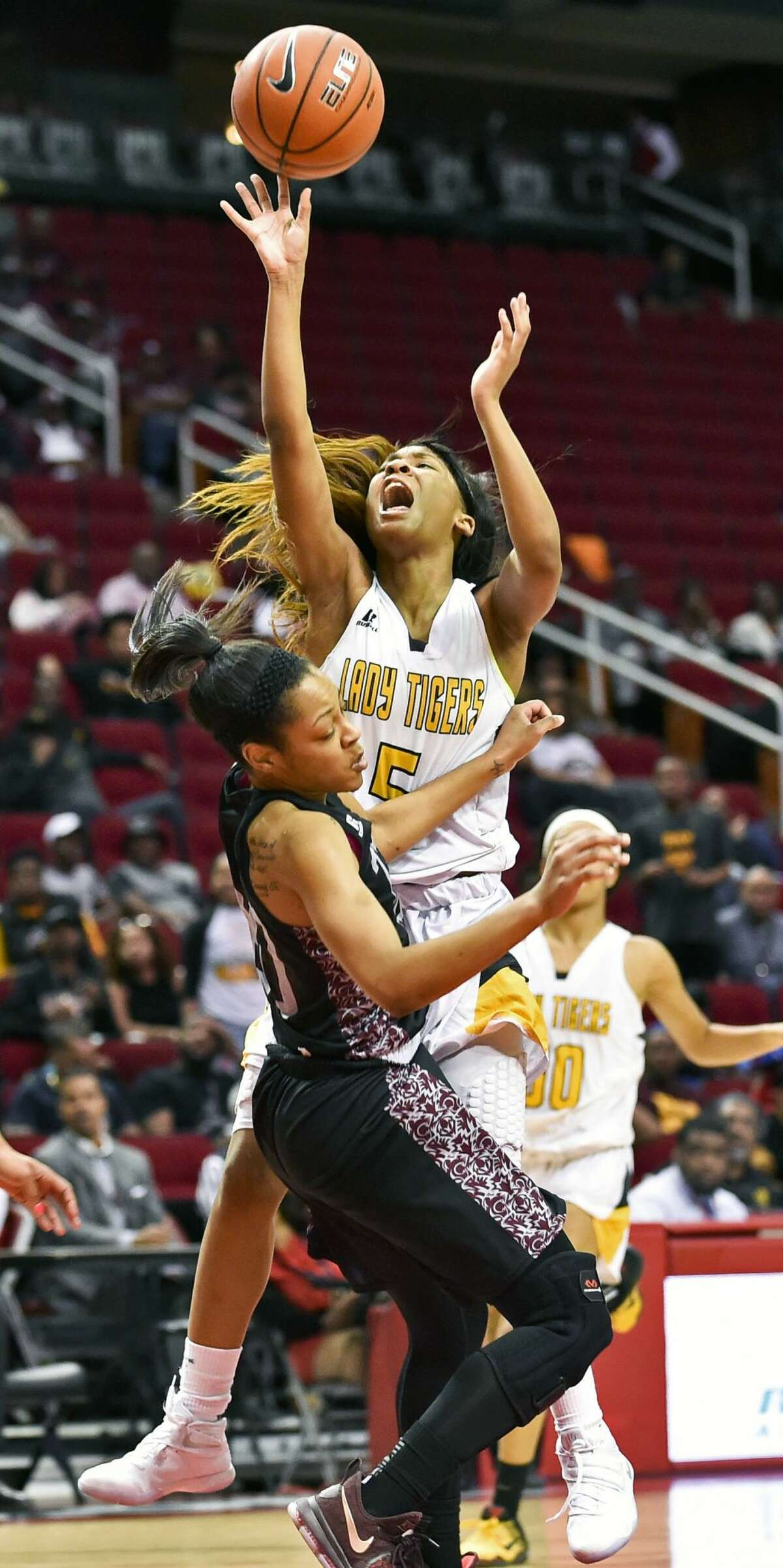 Grambling guard Shakyla Hill (5) shoots over Texas Southern guard Kaitlyn Palmer during the second half of an NCAA college basketball game in the championship of the Southwestern Athletic Conference, Saturday, March 11, 2017, in Houston. TSU won 70-66. (AP Photo/Eric Christian Smith)