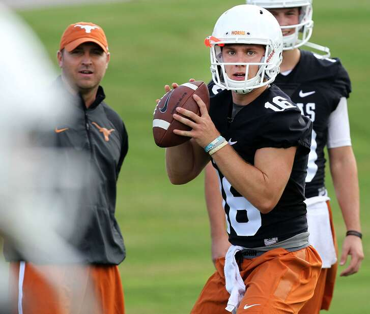 Texas quarterback Shane Buechele (16) looks to make a pass during preseason practice in Austin, Saturday, Aug. 6, 2016. (Stephen Spillman / for Express-News)