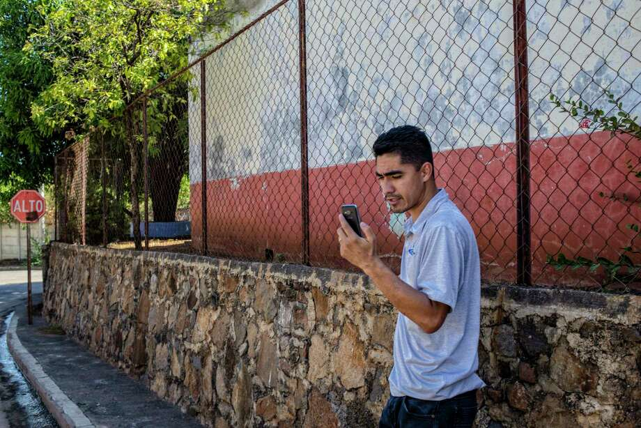 Central America - El Salvador, La Union: Jose speaks to his wife Rosa on a video call, since his arrival to El Salvador after being deported from the USA, it is the only way he can speak and see to his family. Jose Escobar has been deported, he is the father of two, had no criminal record and a temporary protection from deportation but it was removed under President Donald Trump's executive order on immigration enforcement. Photo: Juan Carlos / © Juan Carlos