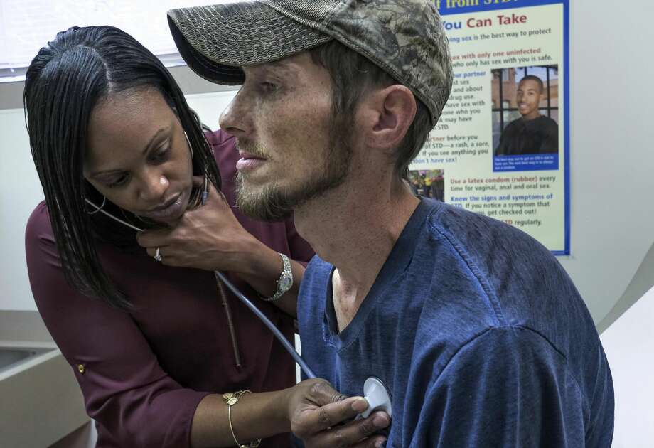 Nurse practitioner Keisha Saunders, who grew up in the community, examines Clarence Workman at the Tug River health clinic in Northfork, West Virginia. Must credit: Washington Post photo by Bonnie Jo Mount Photo: Bonnie Jo Mount/The Washington Post