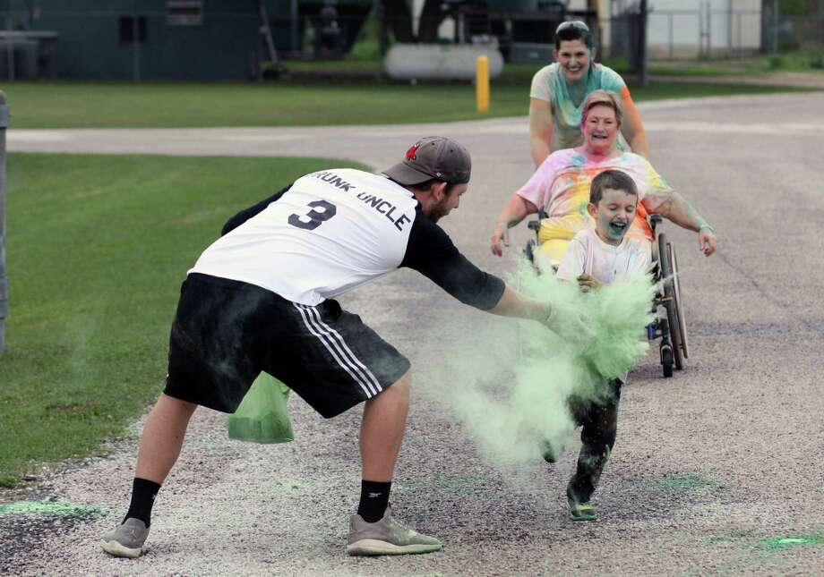 Jackson Kline braces for a dusting of paint as he finishes up one of the final legs of the Second Annual Color Run for North Liberty County Relay for Life on Saturday, March 11, at Tarkington High School. Photo: Vanesa Brashier