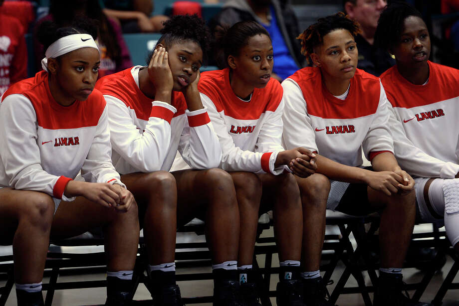 Lamar players watch from the bench as the Cardinals play Stephen F. Austin in the Southland Conference women's basketball tournament at the Merrell Center in Katy on Saturday afternoon.  Photo taken Saturday 3/11/17 Ryan Pelham/The Enterprise Photo: Ryan Pelham / ©2017 The Beaumont Enterprise/Ryan Pelham