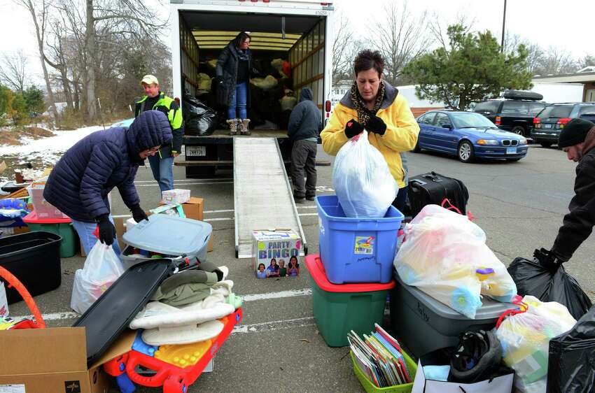 Volunteer Robin Egersheim, holding bag, works with parents and students to receive donated clothing, toys and household items for the JLHS Post Prom Committee FUNDrive at Jonathan Law in Milford, Conn. on Saturday Mar. 11, 2017. The donated materials go to Savers in Orange which pays for everything by the pound. The money will be used to hold a post prom party to be held at Sports Center in Shelton. The junior prom is slated for May 19th.