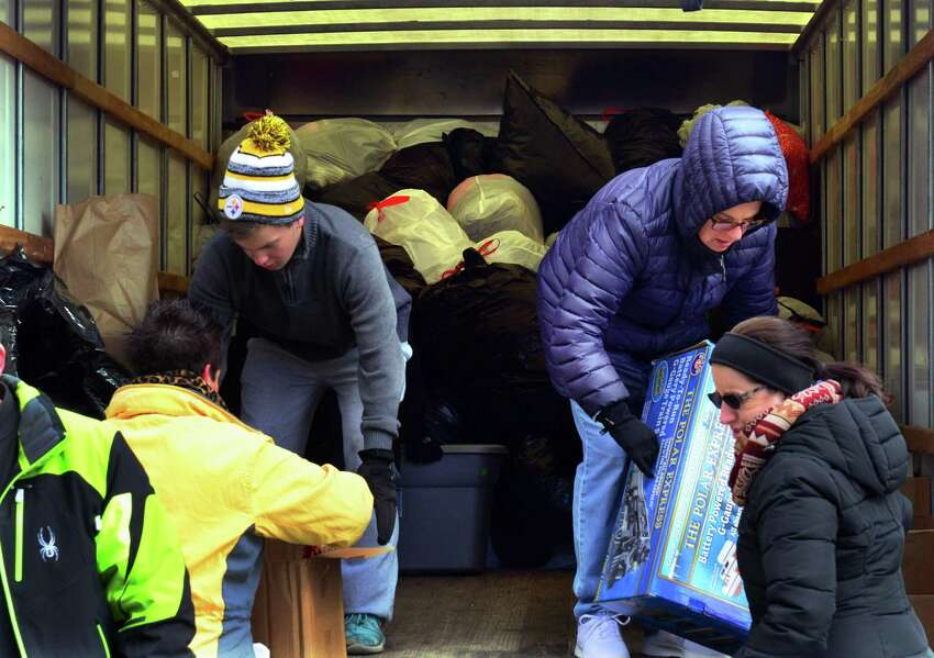 Volunteers Matt Tournas, left, and Ellen Monforte, put donations of clothing, toys and household items into a Buget rental truck for the JLHS Post Prom Committee FUNDrive at Jonathan Law in Milford, Conn. on Saturday Mar. 11, 2017. The donated materials go to Savers in Orange which pays for everything by the pound. The money will be used to hold a post prom party to be held at Sports Center in Shelton. The junior prom is slated for May 19th.