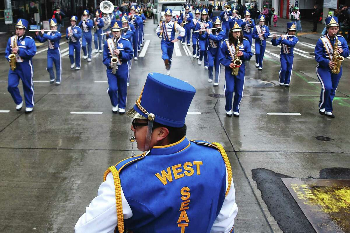 The West Seattle High School marching band performs during the annual St. Patrick's Day parade in downtown Seattle, Saturday, March 11, 2017. (Genna Martin, seattlepi.com)
