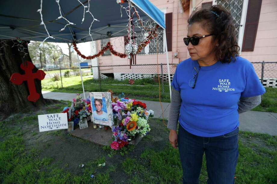 Stella Mireles, who created the Safe Walk Home Northside group, visits the memorial set up for Josue Flores down the street from Marshall Middle School. Mireles was so shaken by the news of 11-year-old Josue's stabbing death that she felt she had to do something. Photo: Karen Warren, Staff Photographer / 2017 Houston Chronicle