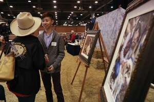 Andy Wei is congratulated after being awarded Grand Champion for 'Timeless' at the Livestock and Rodeo School Art Program.