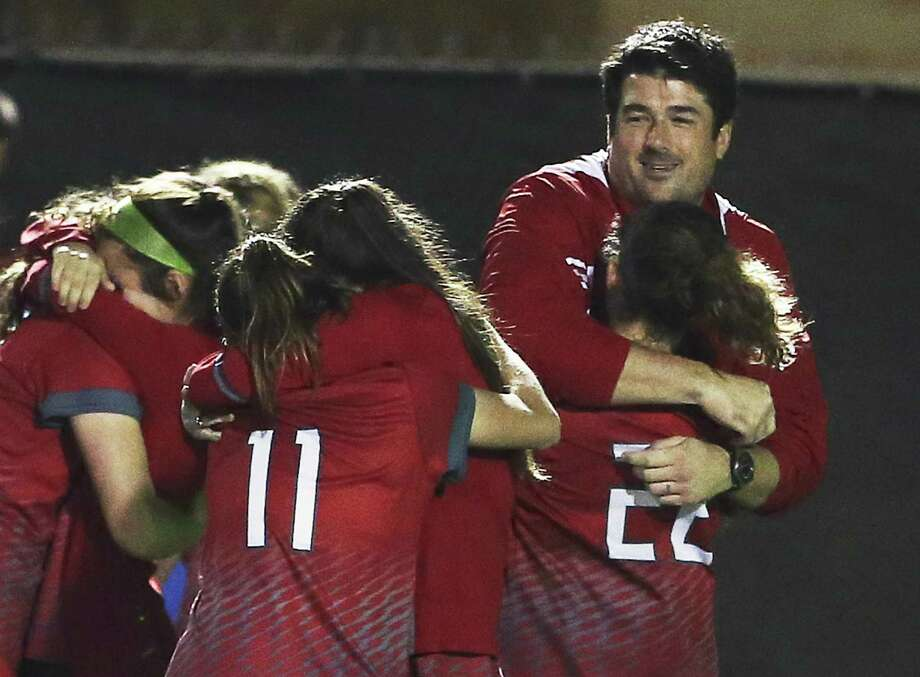Volunteers coach Erik Stolhandske shares in the victory as Lee plays Madison in girls soccer at Comalander Stadium on March 10, 2017. Photo: Tom Reel /San Antonio Express-News / 2017 SAN ANTONIO EXPRESS-NEWS