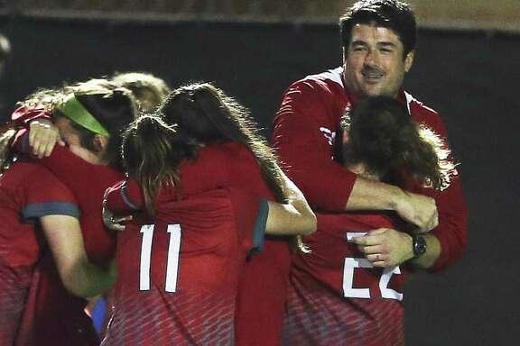 Lee coach Erik Stolhandske shares in the victory over Madison in girls soccer at Comalander Stadium on March 10, 2017.