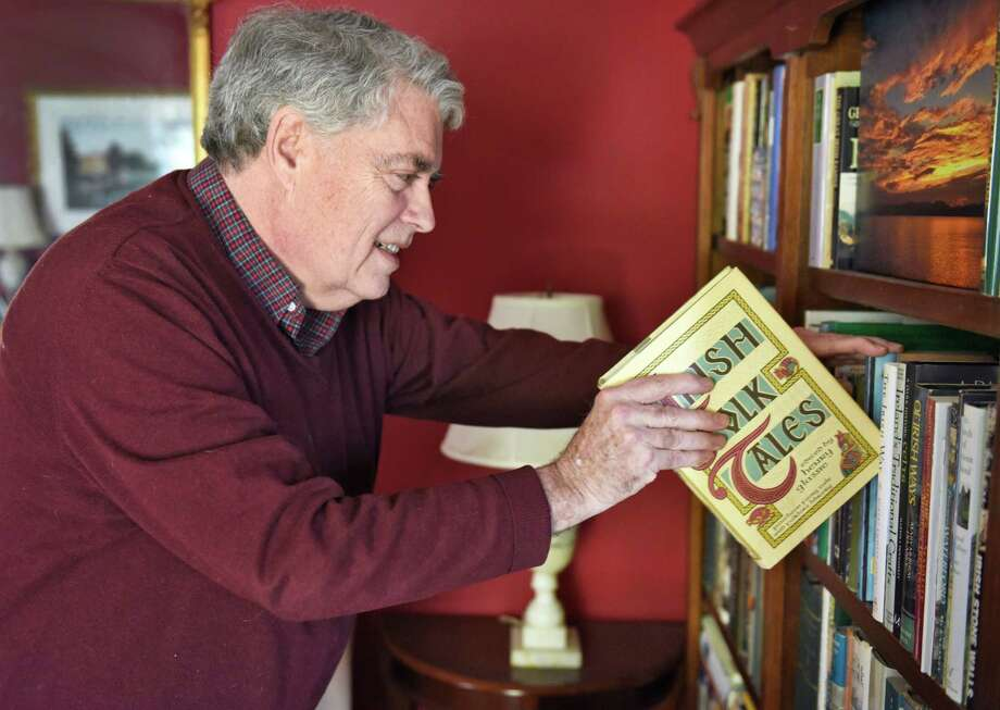 Former Assemblyman, author and noted local historian Jack McEneny replaces a book in his extensive home library Friday March 10, 2017 in Albany, NY. McEneny suffered a stroke two weeks ago that has not affected him physically but has utterly impaired his ability to read. (John Carl D'Annibale / Times Union) Photo: John Carl D'Annibale / 20039934A
