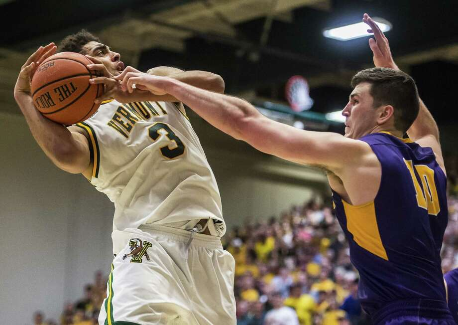 Veromont's Anthony Lamb draws the foul from Albany's Mike Rowley during an NCAA college basketball game in the championship of the America East Conference tournament Saturday, March 11, 2017, at Patrick Gym in Burlington, Vt. Vermont won 56-53. (Ryan Mercer / Burlington Free Press) Photo: Ryan Mercer / © 2017 Ryan Mercer, Burlington Free Press, All Rights Reserved