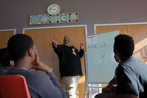 Anthony Sam McNeal gathers the kids together to announce the day's activities at the Reach Ashland Youth Center in San Leandro, Ca.,  as seen on Fri. March 10, 2017.  McNeal is the site coordinator and safety and security monitor at the center.