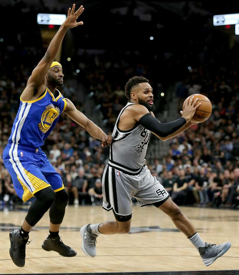 San Antonio Spurs' Patty Mills looks for room around Golden State Warriors' Ian Clark during first half action Saturday March 11, 2017 at the AT&T Center. Photo: Edward A. Ornelas, San Antonio Express-News