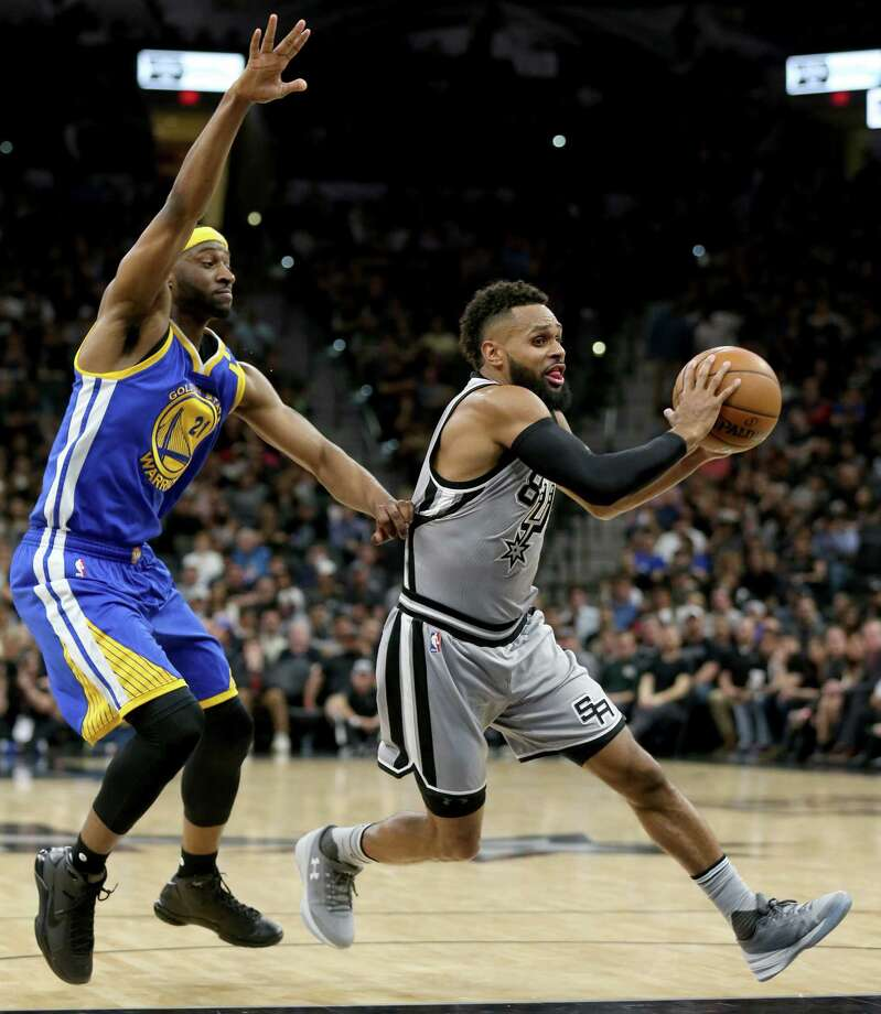 San Antonio Spurs' Patty Mills looks for room around Golden State Warriors' Ian Clark during first half action Saturday March 11, 2017 at the AT&T Center. Photo: Edward A. Ornelas, San Antonio Express-News / © 2017 San Antonio Express-News