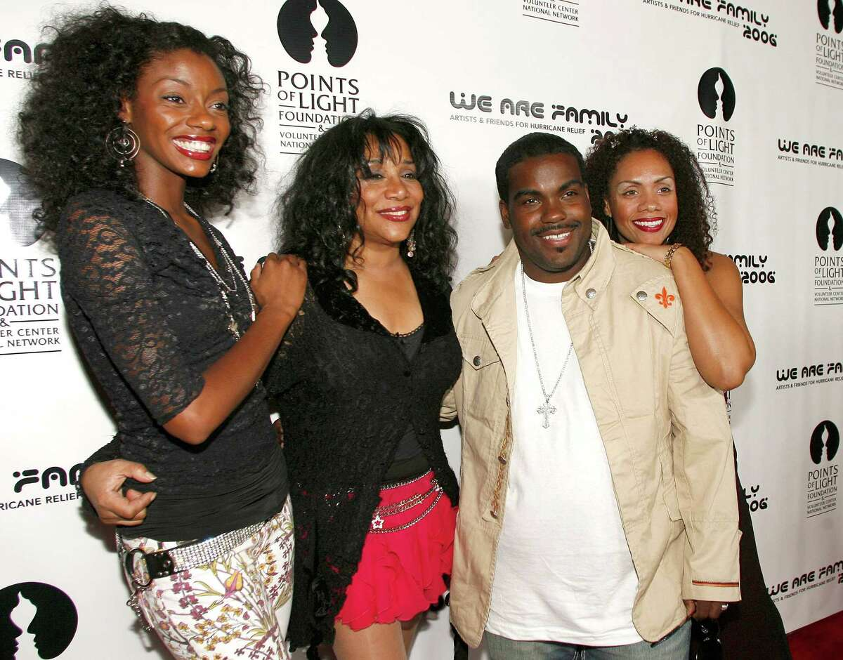 """File- This Aug. 14, 2006 file photo shows Joni Sledge, one of the original members of """"Sister Sledge,"""" second from left, posing with Rodney Jerkins, second from right, her niece Camille Sledge, left, and her cousin Amber Sledge at the """"We Are Family 2006 - All-Star Katrina Benefit CD and Documentary DVD Launch"""" in Century City, Calif. Sledge, who with her sisters recorded the defining dance anthem """"We Are Family,"""" has died, the band's representative says. She was 60. Sledge was found dead in her home by a friend in Phoenix, Arizona, on Friday, the band's publicist, Biff Warren, said Saturday, March 11, 2017. A cause of death has not been determined. (AP Photo/Chris Polk, File)"""