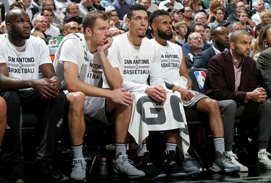San Antonio Spurs' Joel Anthony (from left), David Lee, Danny Green, Patty Mills, and Tony Parker watch first half action against the Golden State Warriors from the bench Saturday March 11, 2017 at the AT&T Center. Photo: Edward A. Ornelas, San Antonio Express-News / © 2017 San Antonio Express-News