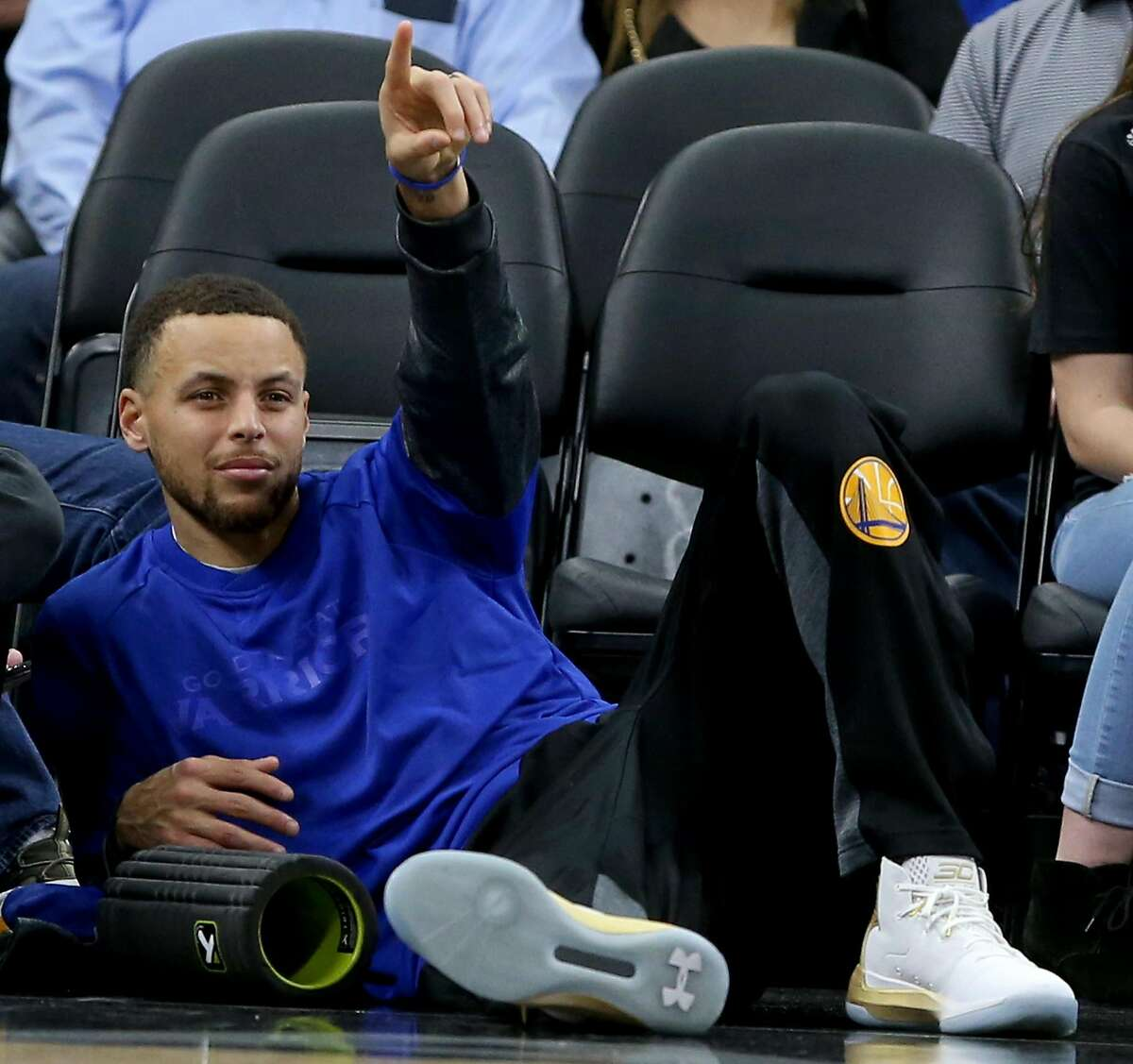 Golden State Warriors' Stephen Curry reacts after a play while watching first half action against the San Antonio Spurs Saturday March 11, 2017 at the AT&T Center.