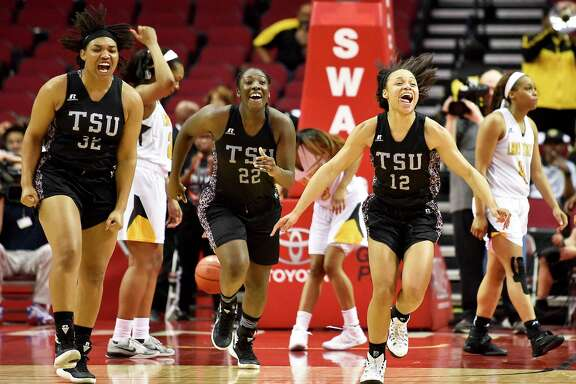 Texas Southern's Nycolle Smith, from left, Breasia McElrath and Chynna Ewing celebrate after winning Saturday's Southwestern Athletic Conference title game.