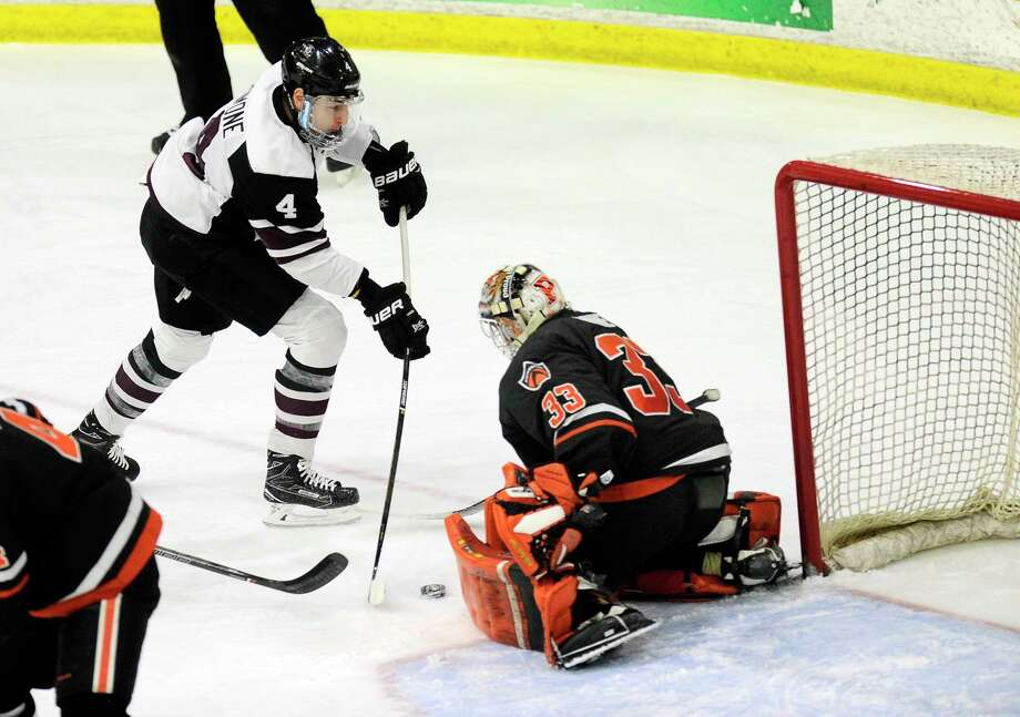 Union's Nick DeSimone (4) scores against Princeton's goaltender Colton Phinney (33) during the first period of a NCAA hockey quarterfinal game of the ECAC conference in Schenectady, N.Y., Saturday, March 11, 2017. (Hans Pennink / Special to the Times Union) ORG XMIT: HP101 Photo: Hans Pennink / Hans Pennink