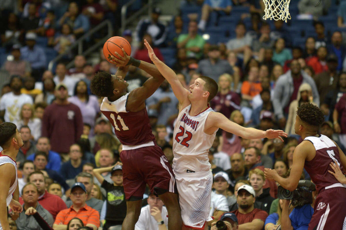 Brazosport junior center Hunter Quick (22) tries to block the shot of Silsbee senior forward Willie Jones (11) during the waning moments of their Class 4A state final versus Silsbee at the Alamodome in San Antonio on Saturday, March 11, 2017. (Photo by Jerry Baker/Freelance)