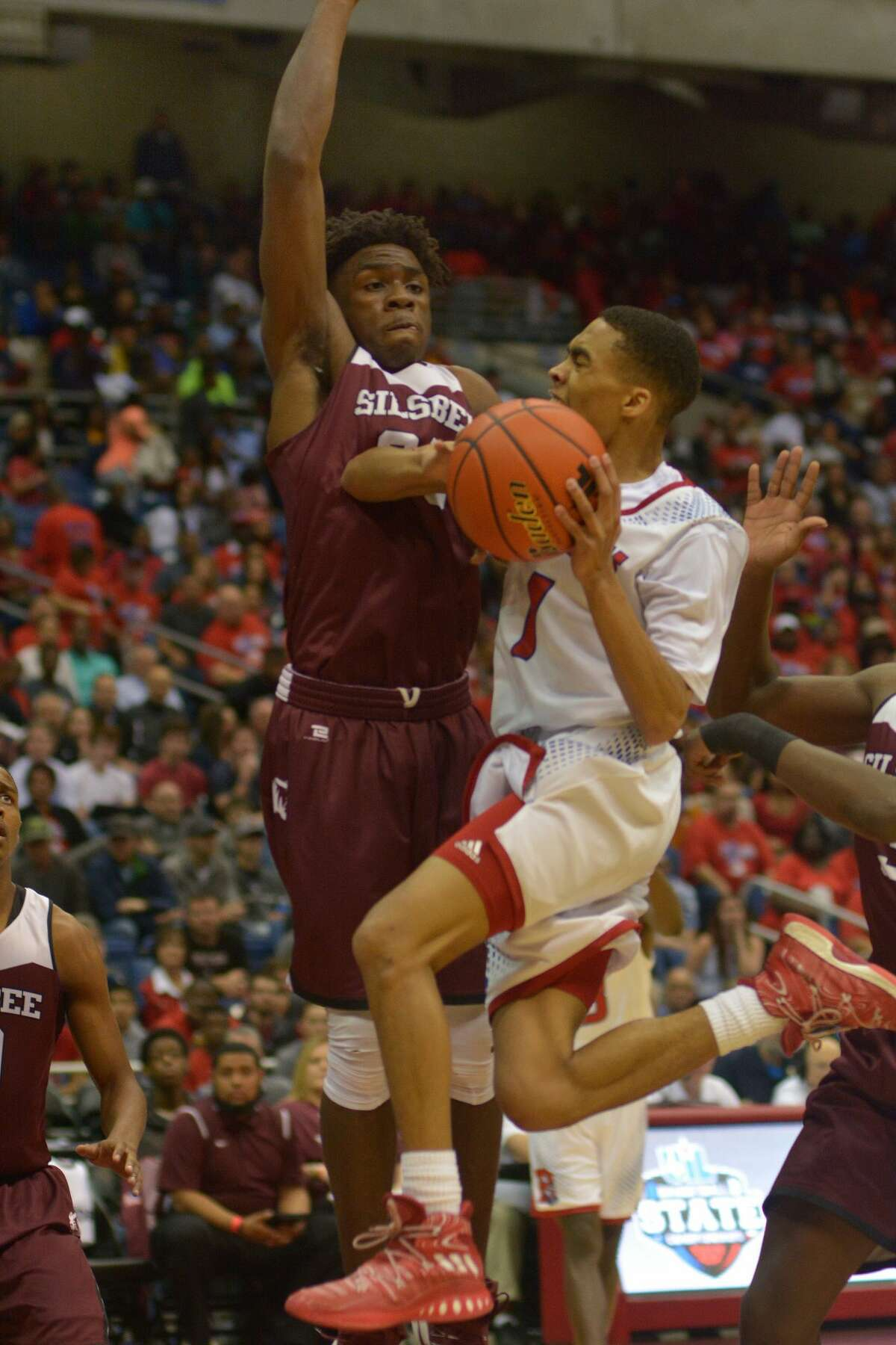 Brazosport senior guard Chris Rossow (1) drives to the basket against Silsbee junior forward Kalon Barnes during the first quarter of their Class 4A state final at the Alamodome in San Antonio on Saturday, March 11, 2017. (Photo by Jerry Baker/Freelance)