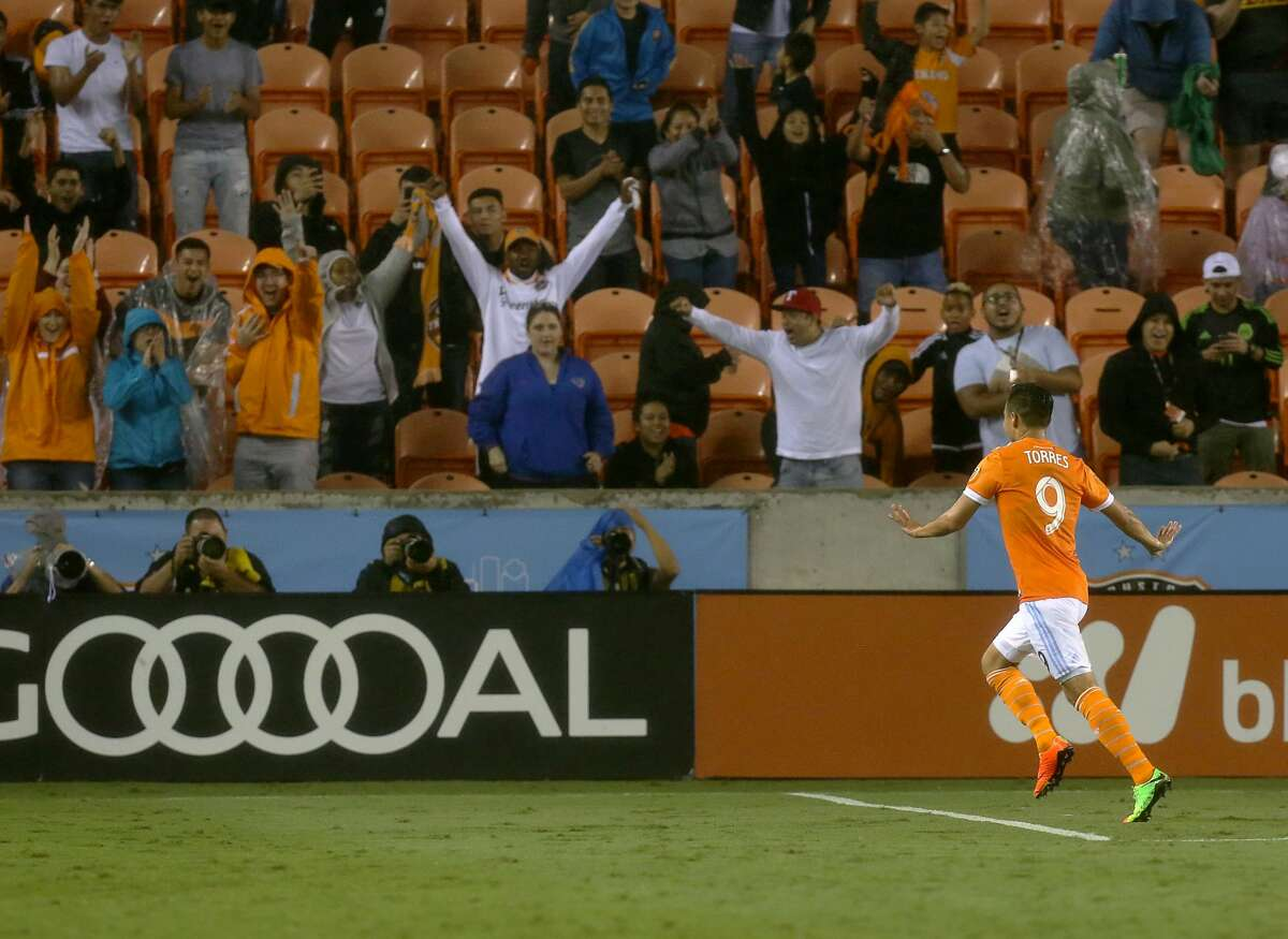 Houston Dynamo forward Erick Torres (9) celebrates a goal with fans during the second half of the MLS soccer game against the Columbus Crew at BBVA Compass Stadium Saturday, March 11, 2017, in Houston. The Dynamos defeated the Crews 3-1. ( Yi-Chin Lee / Houston Chronicle )