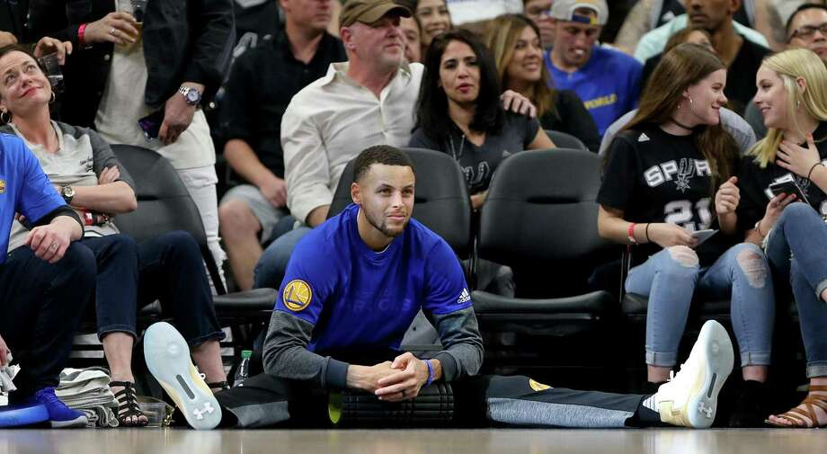 Golden State Warriors' Stephen Curry relaxes while watching first half action against the Spurs on March 11, 2017 at the AT&T Center. Photo: Edward A. Ornelas /San Antonio Express-News / © 2017 San Antonio Express-News