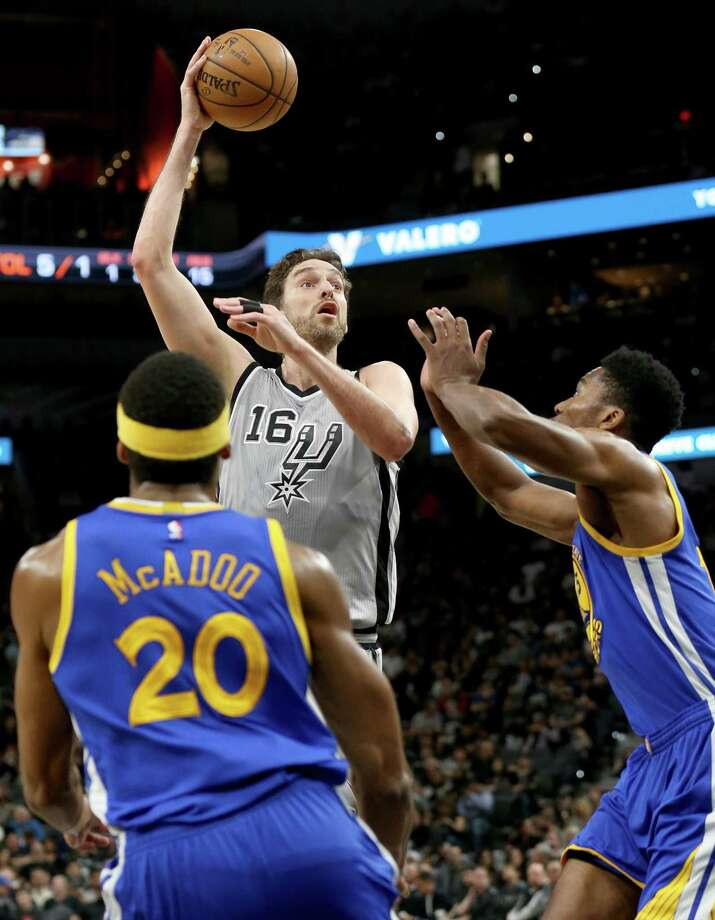 San Antonio Spurs' Pau Gasol shoots between Golden State Warriors' James Michael McAdoo (left) and Damian Jones during first half action Saturday March 11, 2017 at the AT&T Center. Photo: Edward A. Ornelas, Staff / San Antonio Express-News / © 2017 San Antonio Express-News