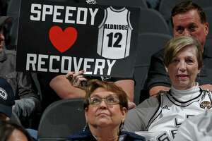 A Spurs fan holds a sign for LaMarcus Aldridge before the game with the Golden State Warriors Saturday March 11, 2017 at the AT&T Center.