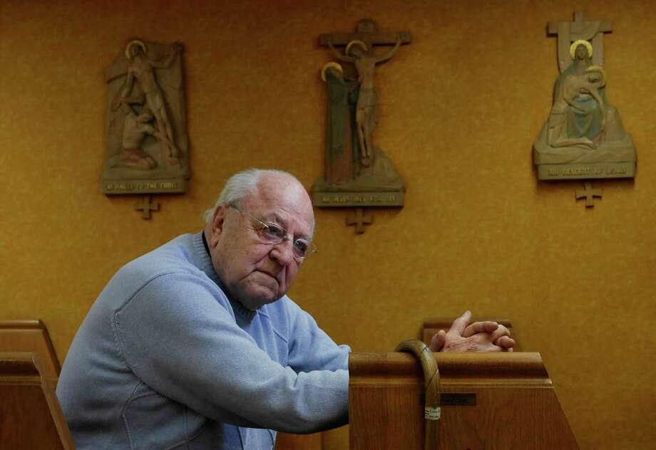 Father Peter Young sits inside St. Mary's Chapel in the basement of the Picot Building on Thursday, March 9, 2017, in Albany, N.Y.  Father Young holds a noon time mass in the chapel Monday through Friday each week.    (Paul Buckowski / Times Union) Photo: PAUL BUCKOWSKI / 20039916A