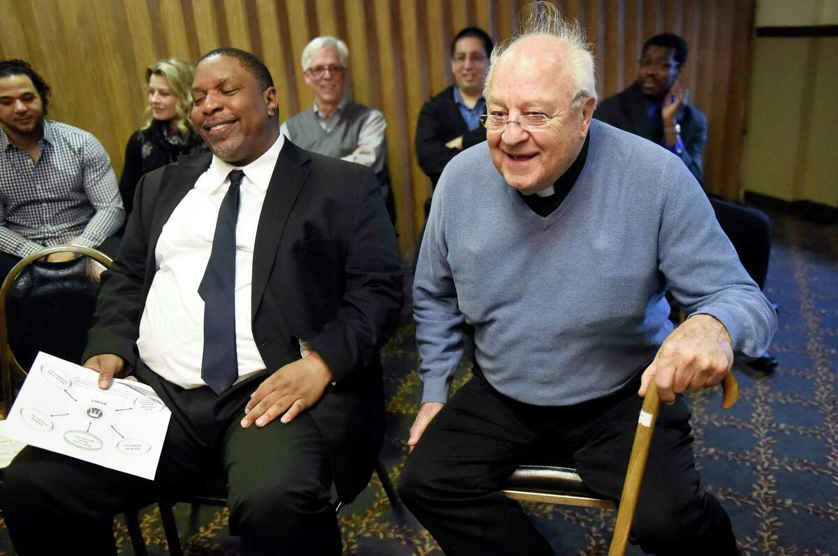 Father Peter Young, right, speaks during the gathering on Friday, April 8, 2016, at the Schuyler Inn in Menands, N.Y. Recovering addicts, who went through Father Peter Young's programs, were reunited after two decades. (Cindy Schultz / Times Union)