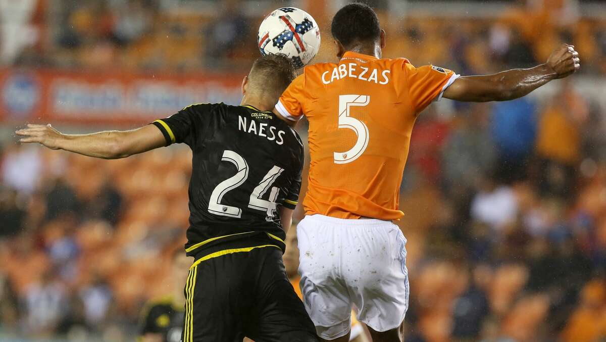 Columbus Crew defender Nicolai Naess (24) and Houston Dynamo midfielder Juan Cabezas (5) goes up for a header during the second half of the MLS soccer game at BBVA Compass Stadium Saturday, March 11, 2017, in Houston. The Dynamos defeated the Crew 3-1. ( Yi-Chin Lee / Houston Chronicle )