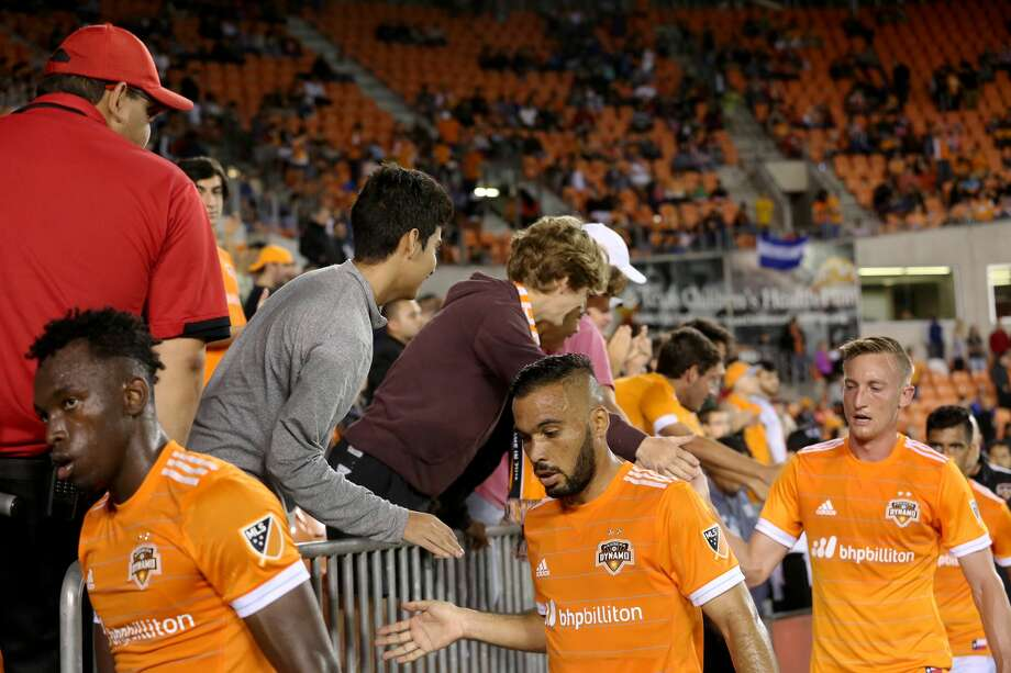 Houston Dynamo players high-five fans during the half time of the MLS soccer game against the Columbus Crew at BBVA Compass Stadium Saturday, March 11, 2017, in Houston. The Dynamos defeated the Crew 3-1. ( Yi-Chin Lee / Houston Chronicle ) Photo: Yi-Chin Lee/Houston Chronicle
