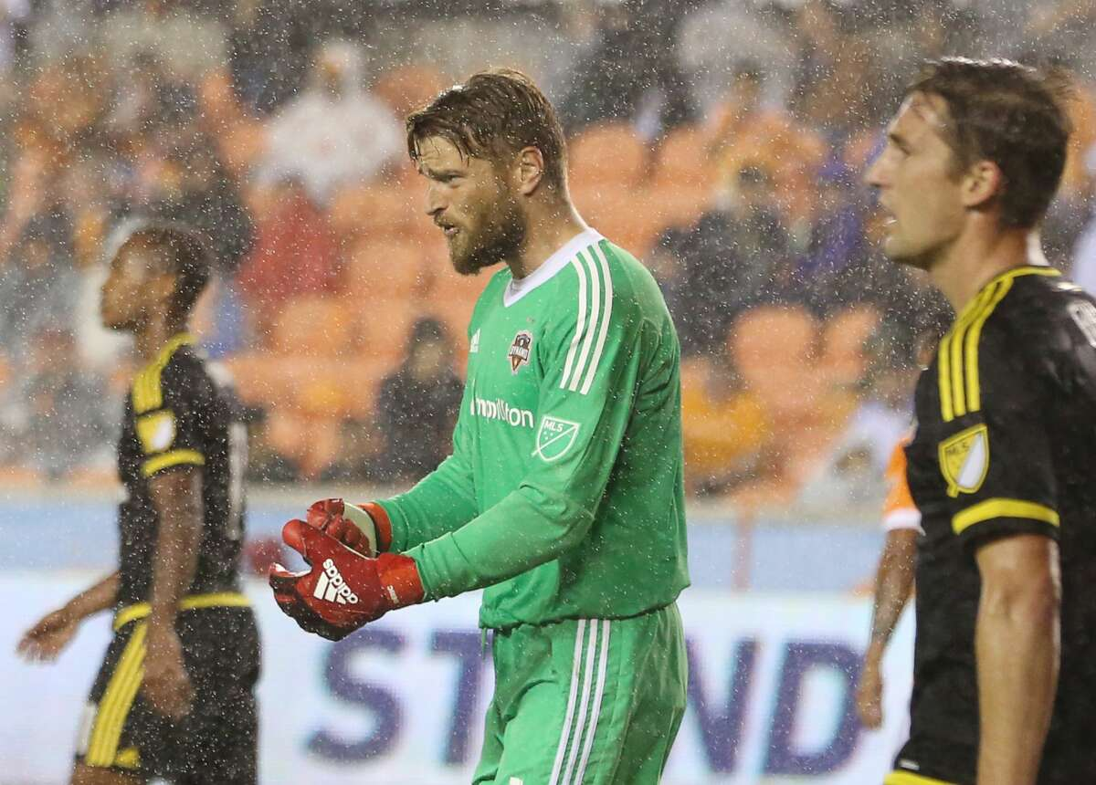 Houston Dynamo goalkeeper Tyler Deric (1) communicates with his teammates during a rain game agaisnt Columbus Crew MLS soccer game at BBVA Compass Stadium Saturday, March 11, 2017, in Houston. The Dynamos defeated the Crews 3-1. ( Yi-Chin Lee / Houston Chronicle )