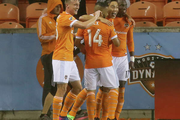 Houston Dynamo forward Erick Torres (9) and teammates celebrate his score during the second half of the MLS soccer game against the Columbus Crew at BBVA Compass Stadium Saturday, March 11, 2017, in Houston.  The Dynamos defeated the Crew 3-1. ( Yi-Chin Lee / Houston Chronicle )