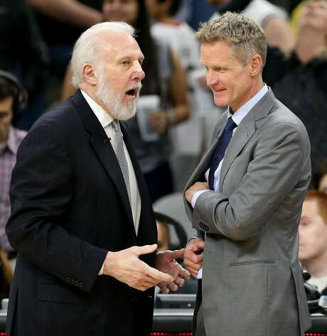 San Antonio Spurs head coach Gregg Popovich talks with Golden State Warriors head coach Steve Kerr after the game held Saturday March 11, 2017 at the AT&T Center. The Spurs won 107-85. Photo: Edward A. Ornelas, San Antonio Express-News