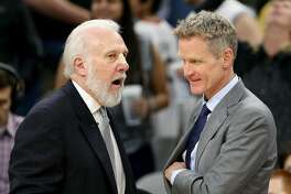 San Antonio Spurs head coach Gregg Popovich talks with Golden State Warriors head coach Steve Kerr after the game held Saturday March 11, 2017 at the AT&T Center. The Spurs won 107-85.