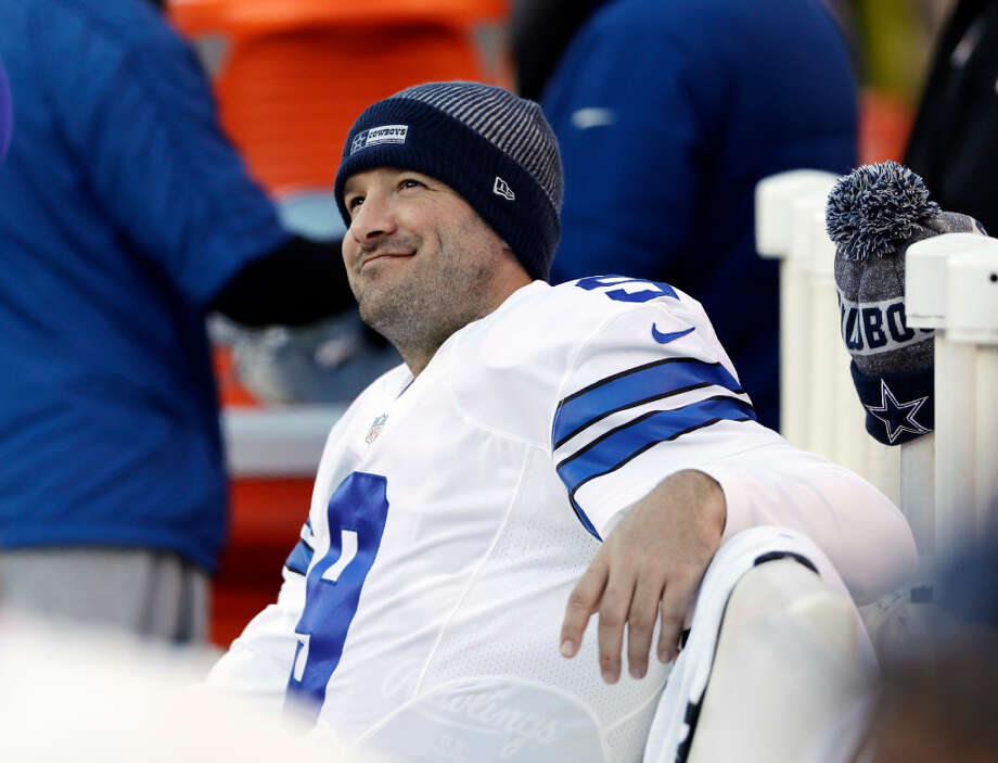 FILE - In this Jan. 1, 2017, file photo, Dallas Cowboys' Tony Romo smiles on the bench during the second half of an NFL football game against the Philadelphia Eagles in Philadelphia. A person with knowledge of the decision tells The Associated Press that the Dallas Cowboys will release quarterback Tony Romo when the NFL year opens on Thursday. The person spoke to The Associated Press on Wednesday, March 8, 2017, on condition of anonymity because the team hasn't announced a decision on Romo, who will get a chance to pursue a starting job elsewhere. (AP Photo/Matt Rourke, File)