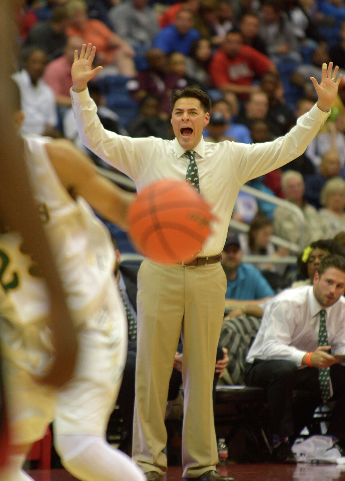 Cy Falls head coach Richard Flores shouts instructions to his team during the 2nd quarter of their Class 6A state final versus San Antonio Wagner at the Alamodome in San Antonio on Saturday, March 11, 2017. (Photo by Jerry Baker/Freelance)