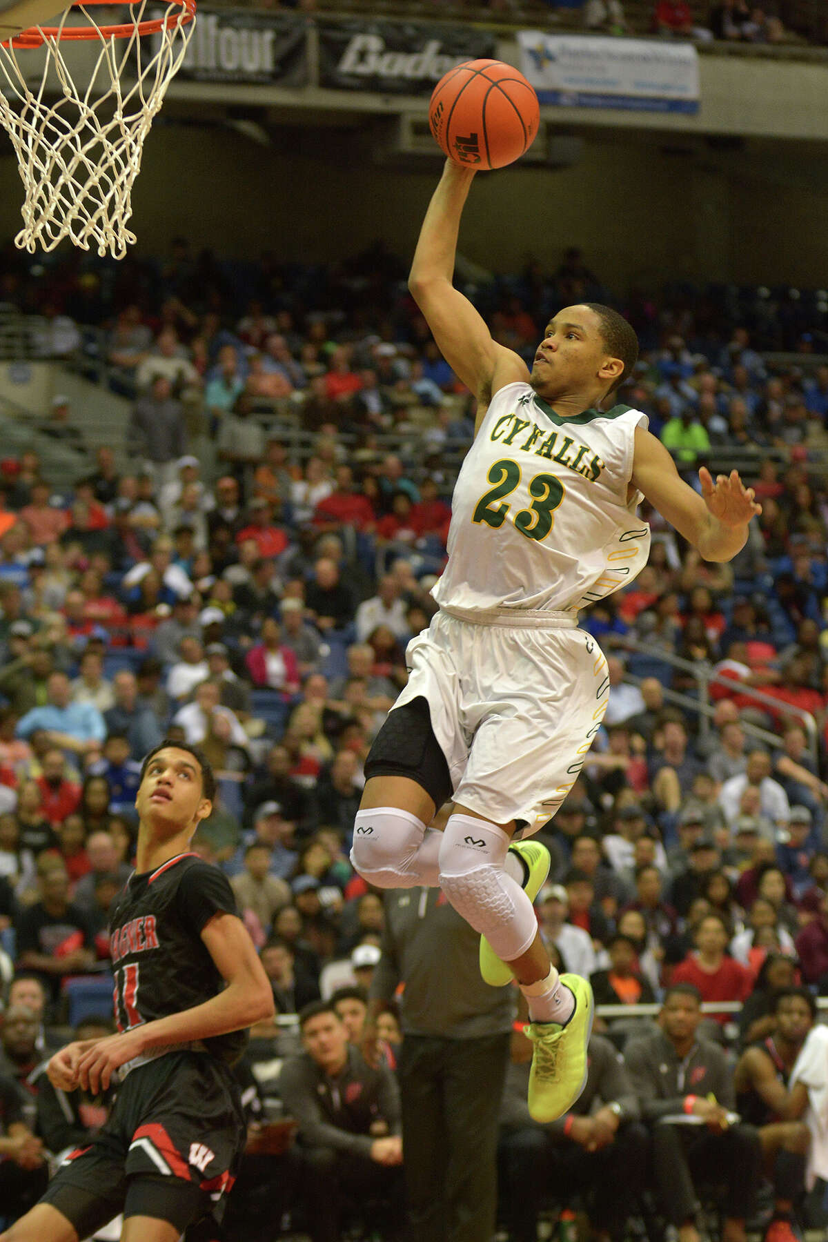 Cy Falls junior guard Nigel Hawkins (23) skies for a dunk against San Antonio Wagner during the 2nd quarter of their Class 6A state final at the Alamodome in San Antonio on Saturday, March 11, 2017. (Photo by Jerry Baker/Freelance)