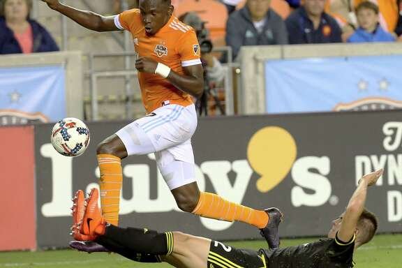 Dynamo forward Alberth Elis, left, attempts to dodge Columbus defender Jukka Raitala during the first half Saturday at BBVA Compass Stadium. Elis scored the Dynamo's second goal in the 35th minute.